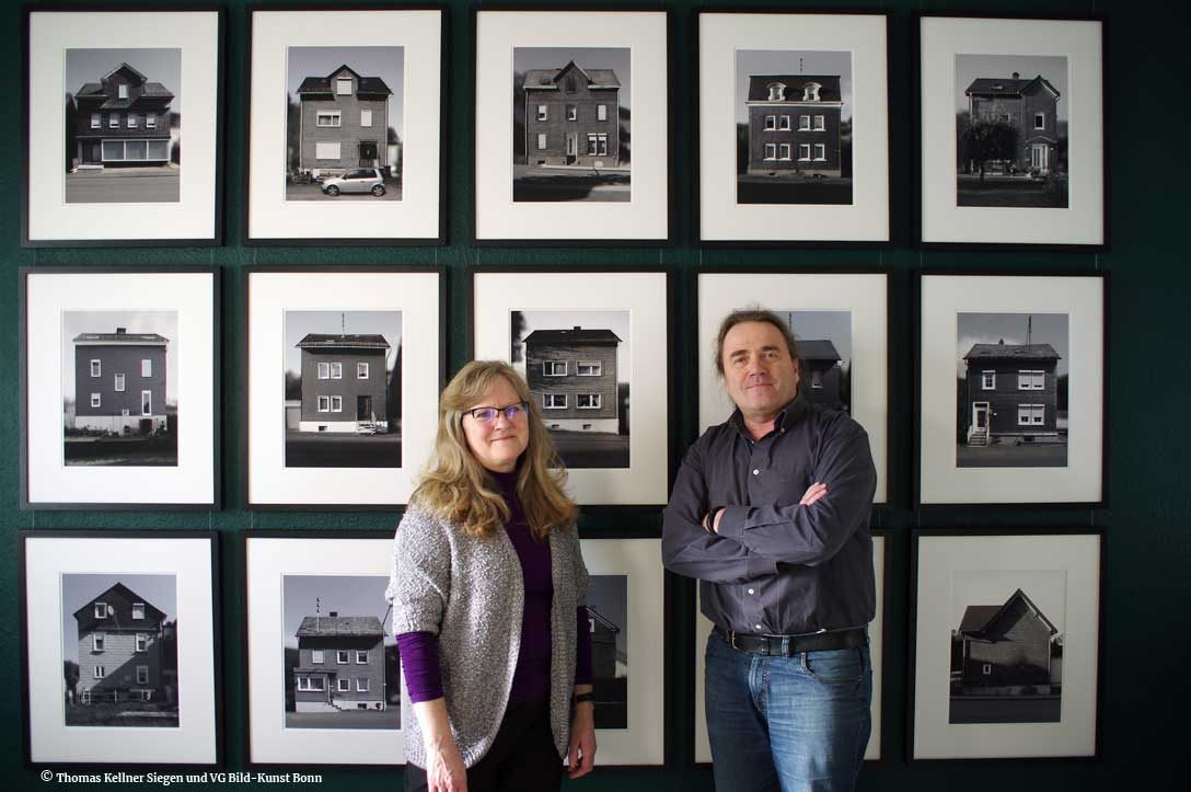Helga and Thomas Kellner in front of the new works of halftimbered houses